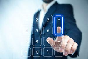 Businessman touching virtual calculator